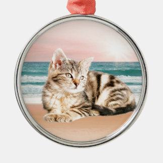 A Cuter Striped Cat Sitting on Beach with sunset Silver-Colored Round Ornament