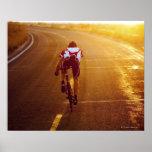 A cyclist on road bike near Great Salt Lake Poster