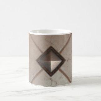A decorative mug and unique coffee cup