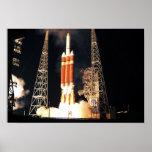 A Delta IV Heavy rocket lifts off Poster