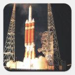 A Delta IV Heavy rocket lifts off Square Sticker