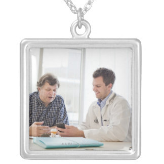 A doctor meeting with a patient and talking and square pendant necklace