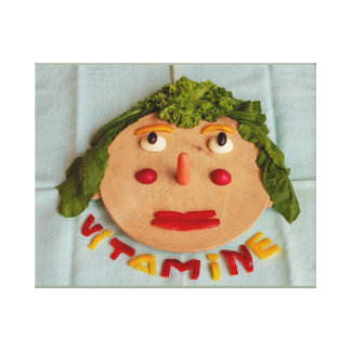 a face  of  vegetables on wrapped canvas