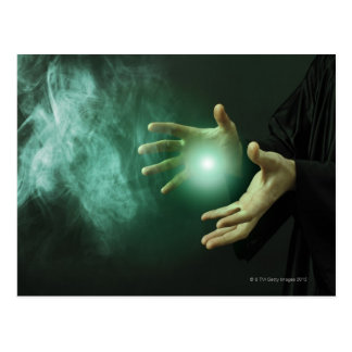 A fantasy wizard making magic with his hands. postcard