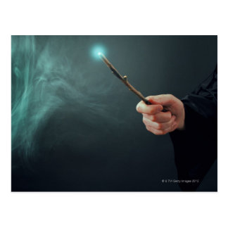 A fantasy wizard making magic with wand. postcard