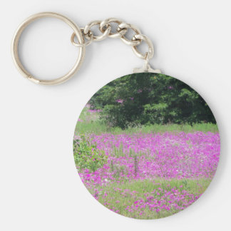 A field of pink spring wildflowers keychain
