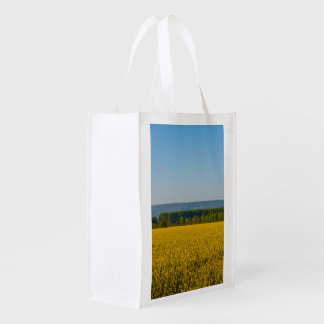 a field of yellow rapeseed  on  reusable bag