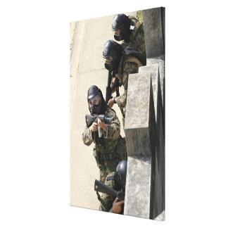 A fire team returns fire from a balcony canvas print