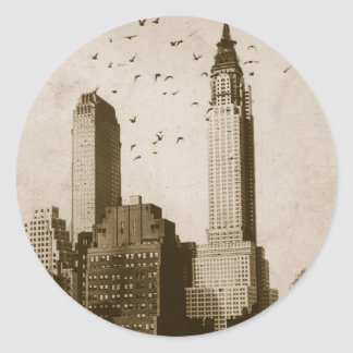 A flock of birds flying classic round sticker