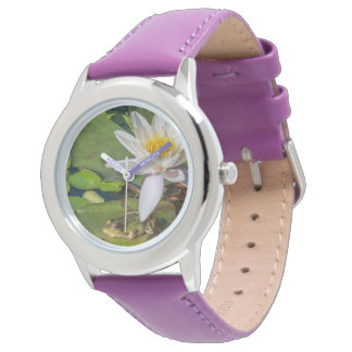 A frog under a flower of water lily watch