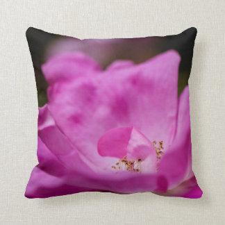 A fuchsia rose throw pillow