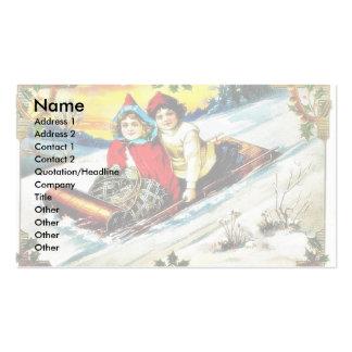 A girl and a boy snow slading on a snow land business card templates