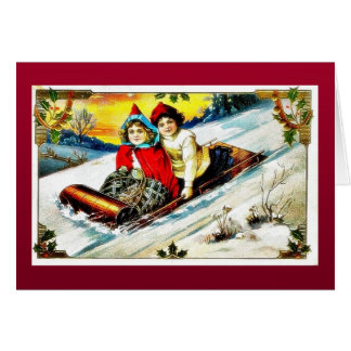 A girl and a boy snow slading on a snow land greeting card