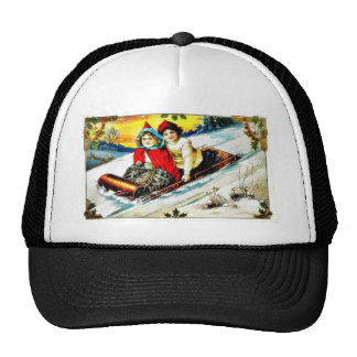 A girl and a boy snow slading on a snow land mesh hat