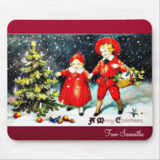 A girl and a boy snow slading on a snow land mouse pad
