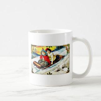 A girl and a boy snow slading on a snow land mugs