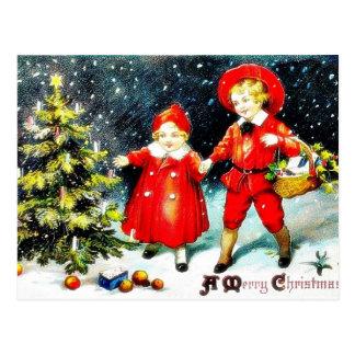 A girl and a boy snow slading on a snow land postcard