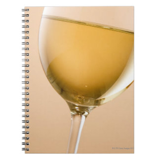 A glass of white wine notebook