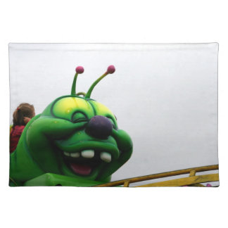 A green caterpillar goofy fair ride image placemat