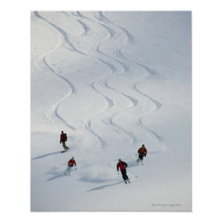 A group of backcountry skiers follow their guide poster