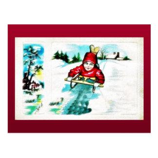 A guy snow slading postcard