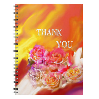 A hand full of thanks tends toward you. note books