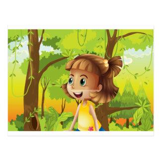 A happy girl near the trees postcard