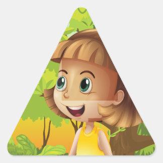 A happy girl near the trees triangle sticker
