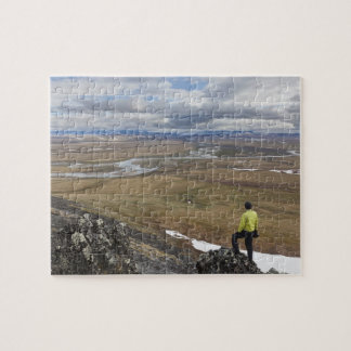 A hiker looks over the Nigu and Etivlik Rivers Jigsaw Puzzle