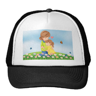 A hilltop with a mother comforting her child trucker hat