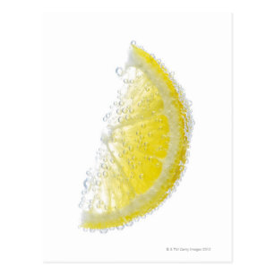 A juicy ripe organic lemon wedge fruit submerged postcard