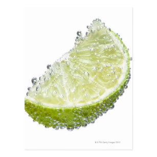 A juicy ripe organic lime wedge fruit submerged postcard