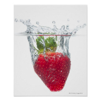 A juicy ripe organic Strawberry fruit splashing Poster