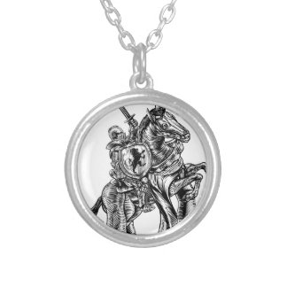 A knight holding a sword and shield on the back of silver plated necklace