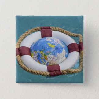 A life preserver and world globe floating 2 inch square button