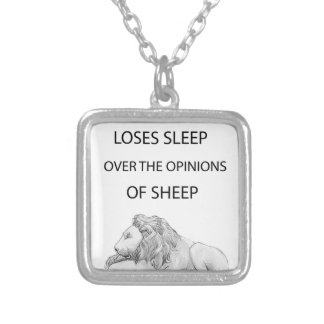 A lion  never silver plated necklace