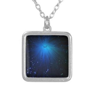 A macro photo of illuminated optical fibers. silver plated necklace