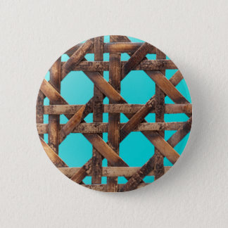 A macro photo of old wooden basketwork. 2 inch round button