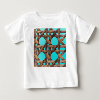 A macro photo of old wooden basketwork. baby T-Shirt