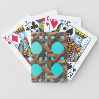 A macro photo of old wooden basketwork. bicycle playing cards