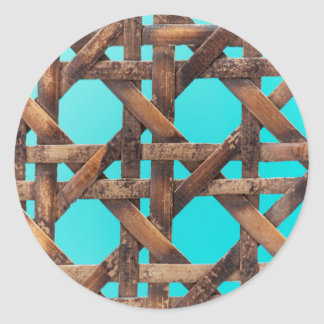 A macro photo of old wooden basketwork. classic round sticker