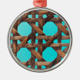 A macro photo of old wooden basketwork. metal ornament