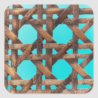 A macro photo of old wooden basketwork. square sticker