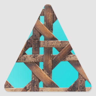 A macro photo of old wooden basketwork. triangle sticker