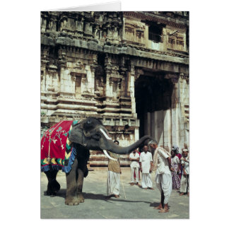 A man being blessed by an elephant card