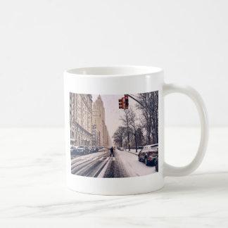 A Man Crossing A Snowy Central Park West Coffee Mug
