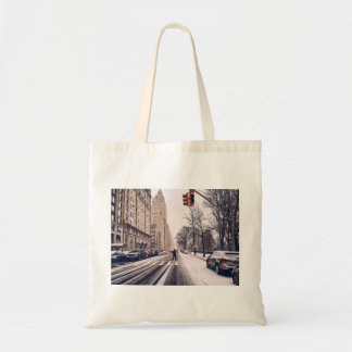 A Man Crossing A Snowy Central Park West Tote Bag