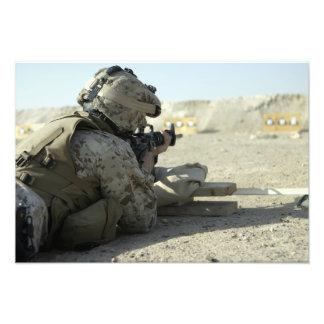 A Marine fires a M16A2 service rifle Art Photo