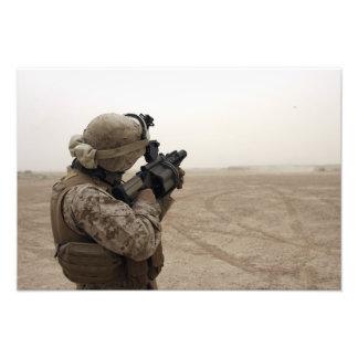 A Marine fires the M-32 Photo Print
