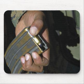 A Marine loads blank ammunition rounds Mouse Pad